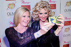 Olivia Newton-John Takes Photo With... Herself?