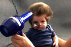 8-week-old baby with oodles of hair gets a blow dry