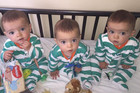 Triplets beat odds of 200 million to one after being born identical
