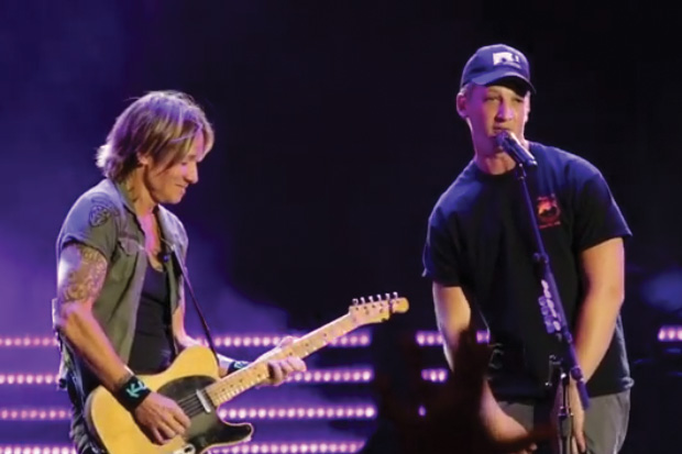 We dare you not to sing along to Keith Urban's duet with actor Miles Teller