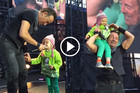 Watch Bruce Springsteen sing on stage with a 4 year-old girl!
