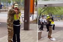 A returning soldier surprised his mother while she was at work