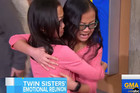 Identical twin sisters adopted by different families meet for the first time